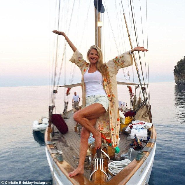 Still fabulous! Christie Brinkley shared this snap of herself on a boat during her Italian vacation, writing, 'A Pirates Life for Me! Yo ho yo ho and a bottle of Vino for me ! Wishing me Hardies and Buckos always the wind at your back!'