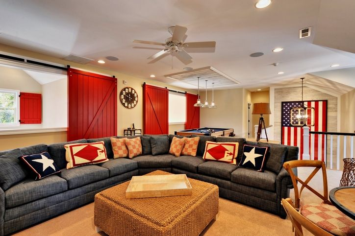 A classic red, white, and blue theme in the recreational room.  Check out the barn doors which hide large out of date windows and make them look terrific!
