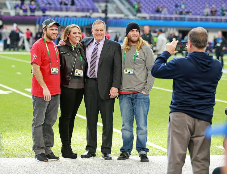 Patriots head coach Bill Belichick poses with his kids Brian, Amanda and Steve, left to right, at Super Bowl LII at US Bank Stadium on Sunday, February 4, 2018. Staff Photo by Matt West