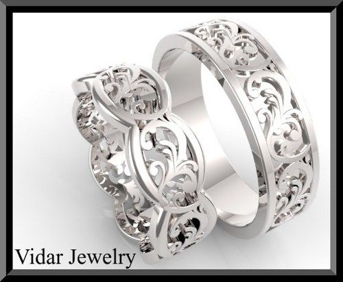 His And Hers Leaf 14K White Gold Matching Wedding Bands Set  unite your hearts forever with this stunning his and hers wedding bands set. what girl could say no to a beauty like this!   details:  SKU: Wedd102   for him:  metal/weight/detail:14K White/Yellow gold about 8Gr.  width: 6mm  thickness: 1.5mm    for her:  metal/weight/detail:14K White/Yellow gold about 5.5Gr.  width: 6.5mm  thickness: 1.5mm $2500