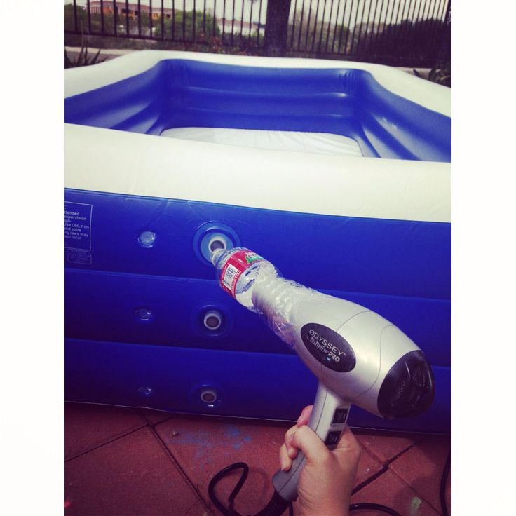 How to blow up a pool without an electric pump. Set a hairdryer on cool, tape a water bottle to the end and just hold the sucker to the pool hole! Filled it up in seconds.