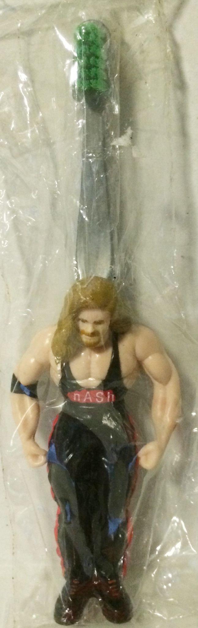 (TAS032248) - 1999 WCW Wrestling Toothbrush Green Bristles - Kevin Nash
