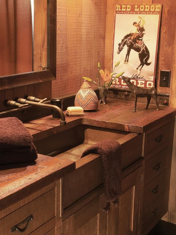 decor southwestern decor with a photo of a cowboy who was riding the horse and flower vase also sink and mirror in bathroom and bathroom cabinet - Western Interior Design Ideas