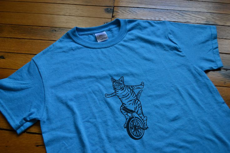 Customizable Cat on a Unicycle graphic t-shirt (https://www.etsy.com/listing/209108653/customizable-cat-on-unicycle-graphic-t)
