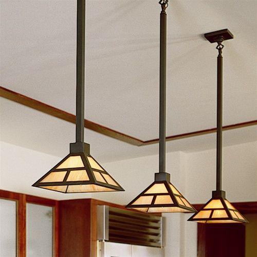 Prairie Style Kitchen Lit With Three Pendant Lights