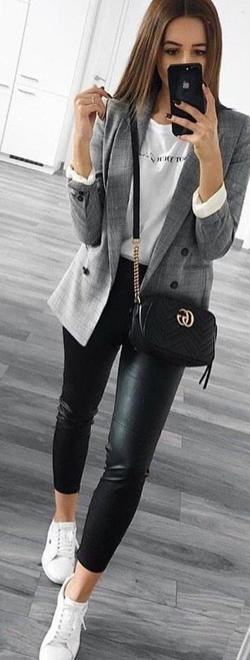 Great #spring #outfits woman wearing gray blazer holding smartphone while standing. Pi…