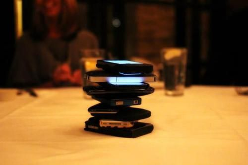 Rules:  1) The game starts after everyone sits down.  2) Everybody places their phone in the middle of the table.  3) The first person to touch their phone loses the game.  4) Loser of the game pays the bill for everyone's meal.  5) If the bill comes before anyone has touched their phone, everybody is declared a winner and pays for their own meal.    The purpose of the game was to get everyone off their phones, away from twitter, facebook, texting, etc and to encourage conversations.: Idea, Friends, Entir Meals, Social Media, Encouragement Conver, Help Cure, Dinners, The Games, Phones
