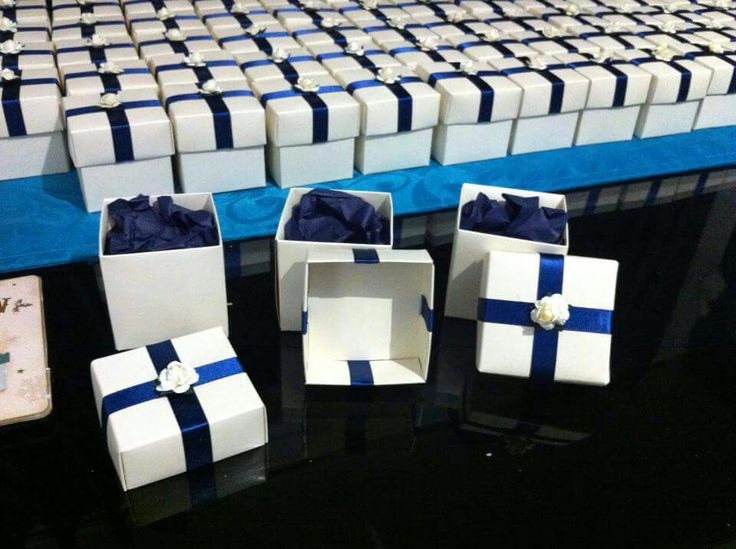 Make Your Own Favours. I think the wedding shop wanted £300 for 150 boxes I payed £30 for 150, £2 for some ribbon £3 for 150 roses & £1 for some tissue paper and then mints to go in. Time comsuming  but saves you a money