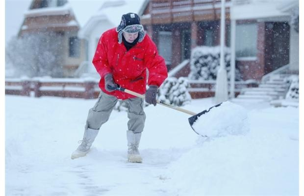 George Hill shovels his walk in Calgary, Alberta on January 10, 2013 after an overnight snowfall.