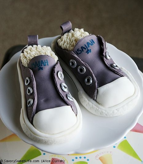 Converse Sneakers Cake: Whoa! What an outstanding job with fondant, edible silver paint and buttercream! Check out the recipe.