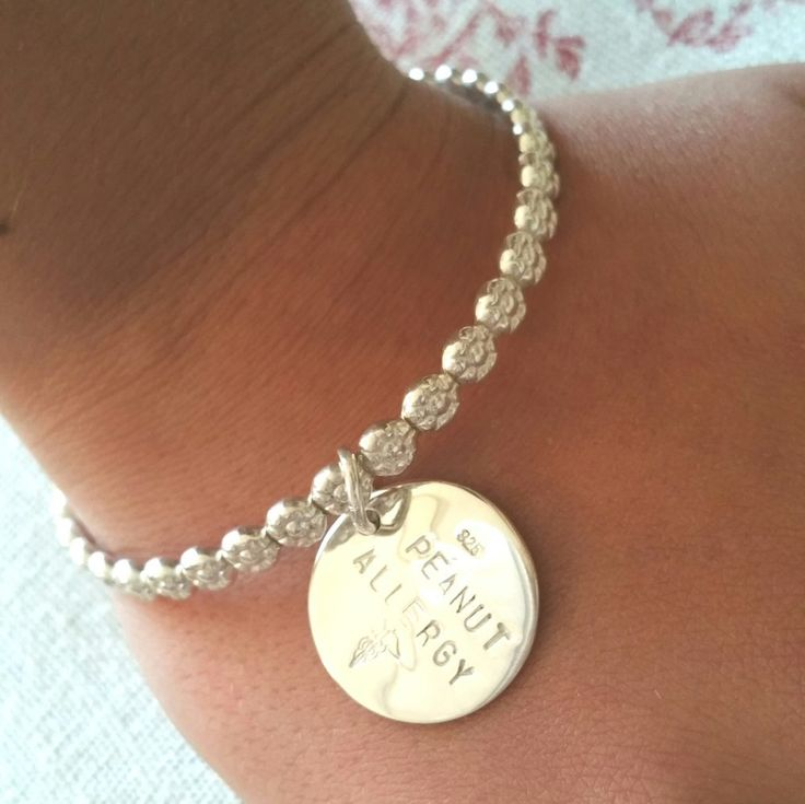 Where flowers bloom, so does hope... Solid sterling round silver flower bangle. Add a heart or round disc charm to this bangle
