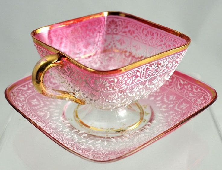 Moser Art Glass Pink to Clear Cup w/saucer, White Enamel & Gold.Pattern:Fans+Frond's Color:Pink shading to clear w/white enamel+ gilt on rims and handle.Circa:1885. Marked: Yes, to center bottom of saucer. Cup is not marked or we couldn't find it.Comments: The hand enameling is outstanding.