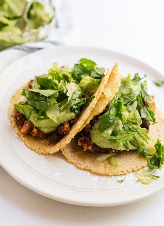 Quinoa and black bean tacos with creamy avocado sauce! This is a simple weeknight meal that's vegan, too.