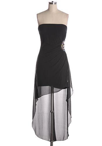 Black hi-lo asymmetrical party dress with multi-coloured jewel accents on waist. Elastic top of bust and side zipper. 65% silk, 35% polyester Not stretchy Lined Fits small Indie, Retro, Party, Vintage, Plus Size, Convertible, Cocktail Dresses in Canada Jewel Tones Dress -