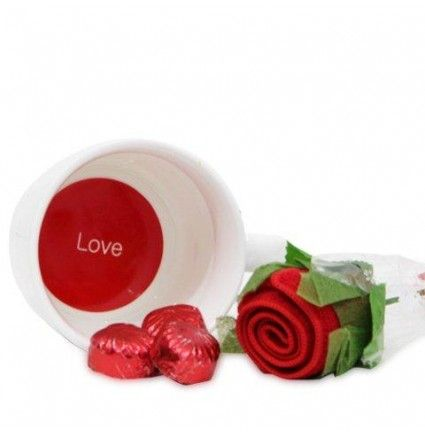 A very cute combo of love printed mug, 100 gms handmade chocolates and a rose shaped napkin on this valentine day.