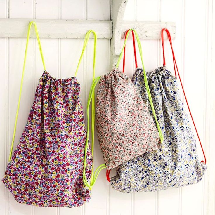 This drawstring bag pattern is so simple to sew: you'll want to make lots because they're so useful: for shopping, gym kit, travelling...
