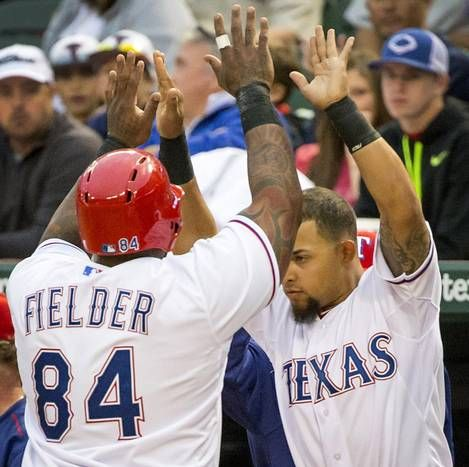 Texas Rangers designated hitter Prince Fielder celebrates with second baseman Rougned Odor after scoring during the first inning against the Los Angeles Angels at Globe Life Park on Monday, April 13, 2015, in Arlington. (Smiley N. Pool/The Dallas Morning News)