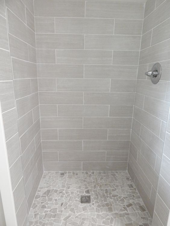 """everything from lowe's: shower walls: 6x24 leonia silver porcelain; floor: delfino arctic topaz pebble mosaic; grout: mapaei #38 """"avalanche"""""""
