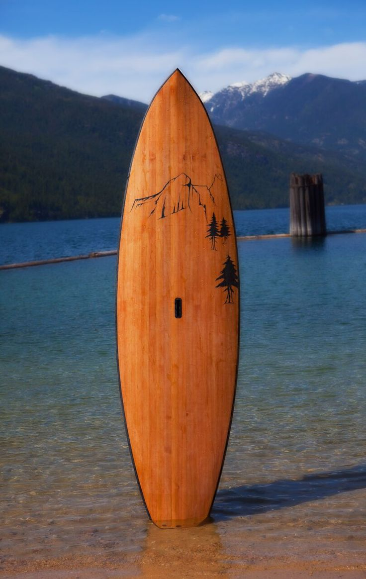 Hollow wooden  stand up paddle board. Mountain art,  Cedar strips with clear deck grip.  knotty board SUPs and more for sale at www.knottyboards.ca