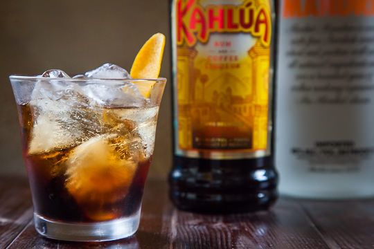 Making these tonight...The Russian Bride 1 oz Kahlúa 1 oz ABSOLUT Mandarin vodka Ice Orange peel