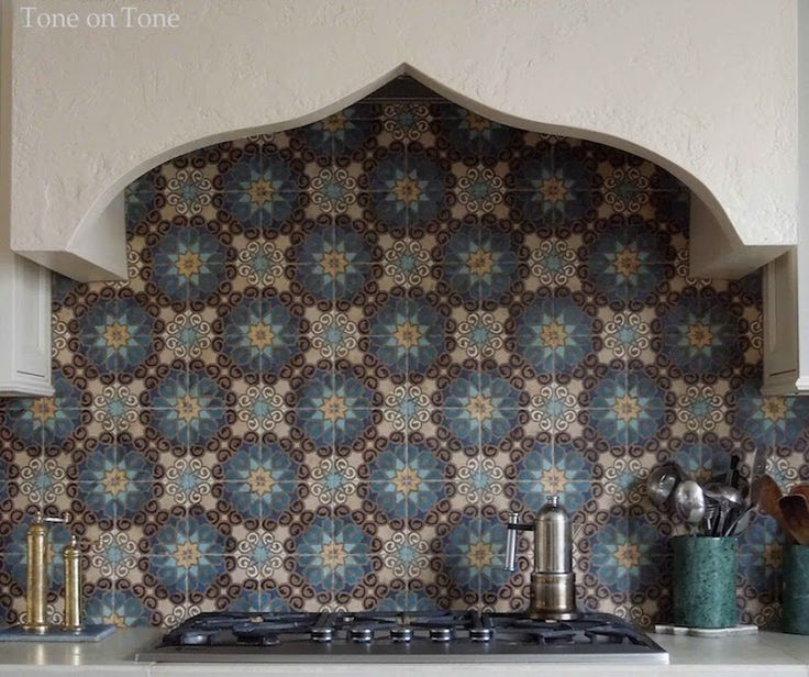 Stunning kitchen with Moroccan shaped stucco oven over cooktop framed by  concrete counters alongside a Moroccan. Moroccan Tile BacksplashMoroccan ...