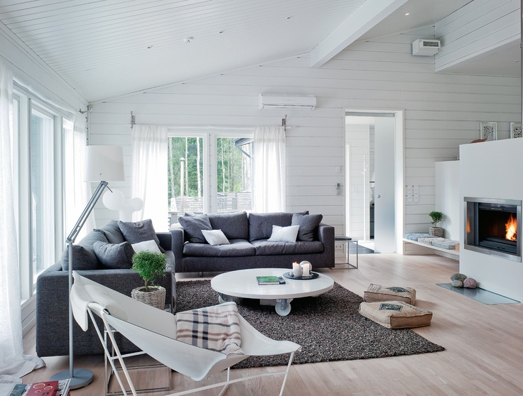 love the white walls and the fireplace