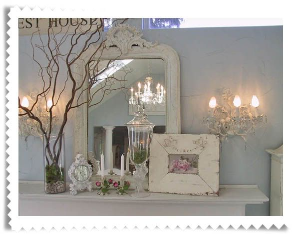 master bedroom idea.  love the white mirror and picture frame, topiary and clock.
