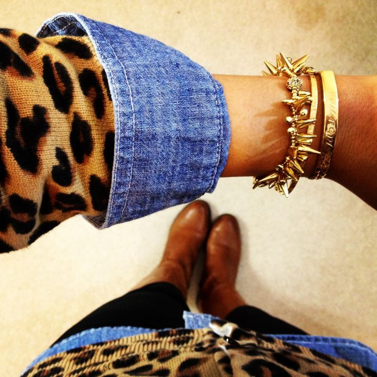 Leopard print cardigan over chambray shirt, black skinny jeans and brown boots. Cute and sophisticated!