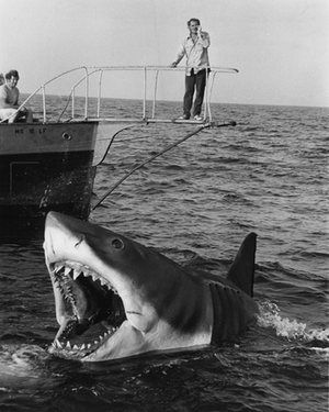 "40 years of Spielberg's Jaws – in picture >> As Steven Spielberg's 1975 monster movie turns 40, we share some lesser-known images from the making and release of a classic  | Photo: Jaws (1975)  Robert Shaw as ""Quint"" on the Orca and the Shark"