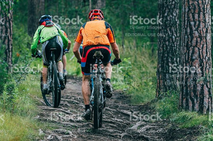 Miass, Russia - July 19, 2015: two mountainbiker in a uphill race during race 'Clean water-2015', Miass, Russia - July 19, 2015