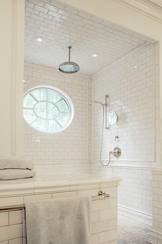 white subway, barely there grout, subtle bullnose accent trim, baseboard-type tile at bottom, wall & ceiling coverage, barrier free, two pinlights opposite a rain shower head.  Could the pinlights be placed in corners, since our stall is so narrow?