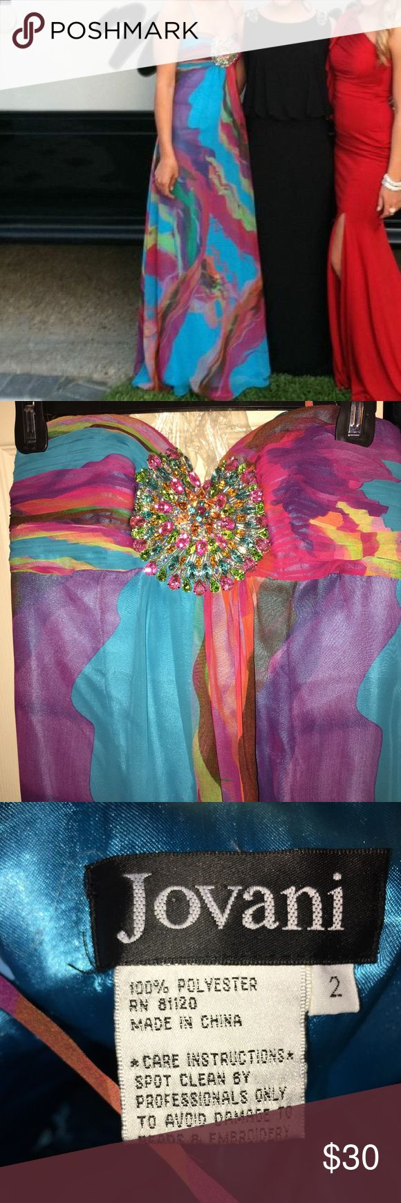 Multi color Formal dress Jovani brand Jovani formal dress- multi colored. Worn once and was dry cleaned. Beautiful dress- all stones still intact. Comes with extra blue fabric. Can be worn strapless or with the strap. Size 2 Jovani Dresses Prom