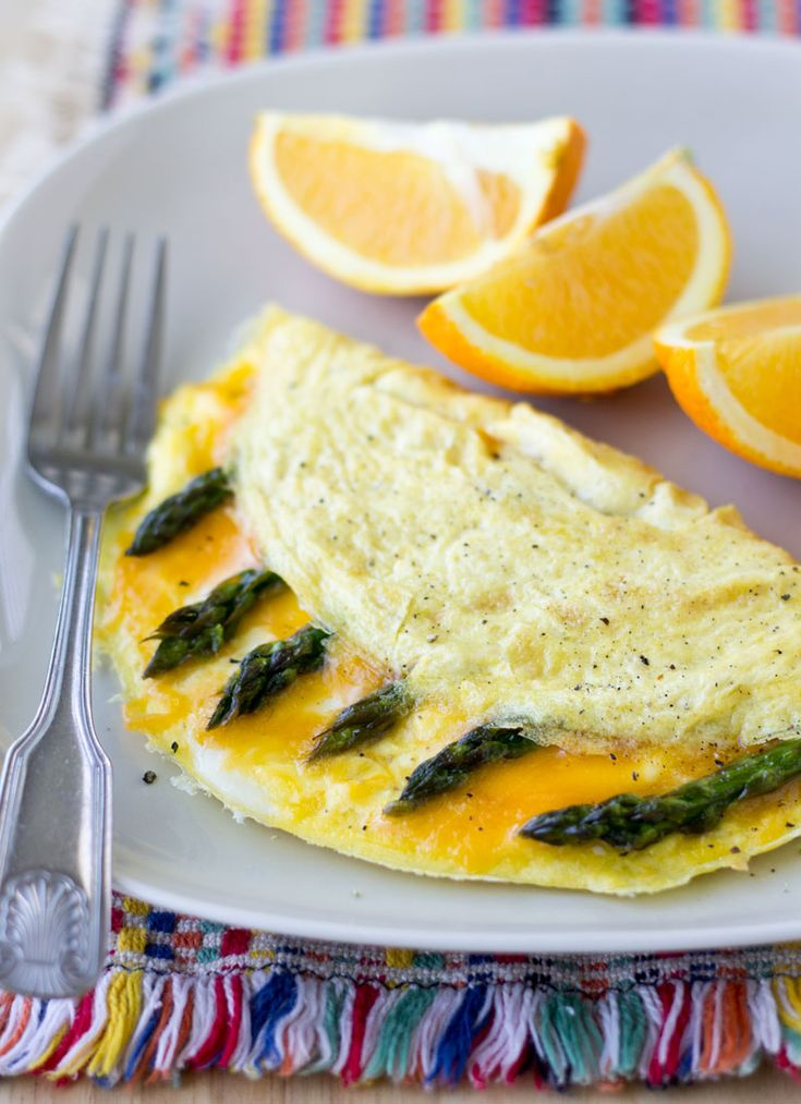 Eat more veggies (and use up whatever is in your fridge!) with an easy Cheddar Cheese and Asparagus Omelette. It's a hot, hearty breakfast ready in minutes!