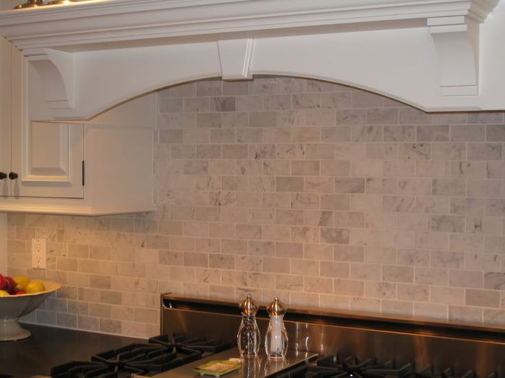 Tumbled Marble Subway Tile Backsplash In Kitchen