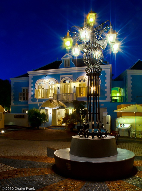 Blue hour in the courtyard of Kura Hulanda Hotel and Museum in Curacao by Chaim Frank
