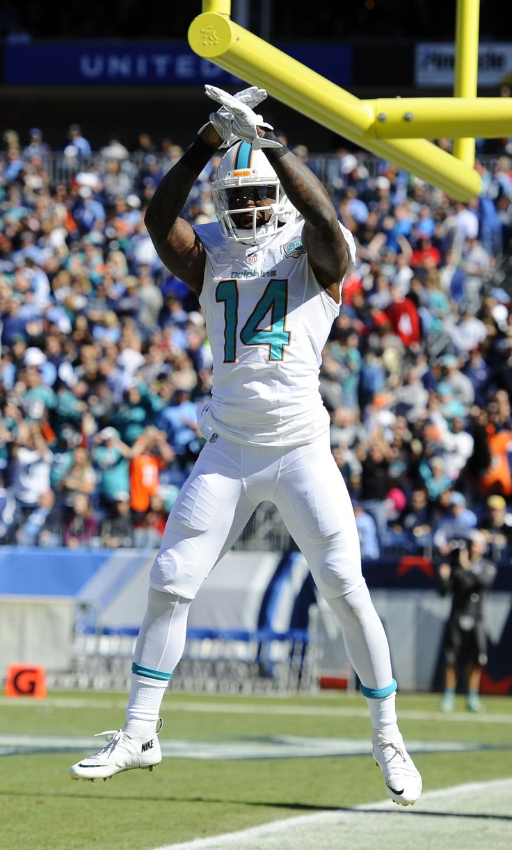 Miami Dolphins receiver Jarvis Landry (14) celebrates after scoring a touchdown. Landry is one of Miami's top offensive weapons. Mandatory Credit: Christopher Hanewinckel-USA TODAY Sports