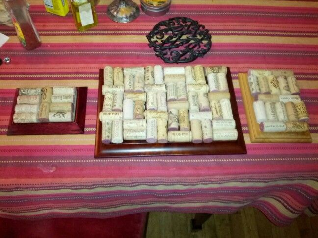 3 trivets made from wine corks, old award plaques and picture frames. Come see us at: http://besustainabletoday.wordpress.com/