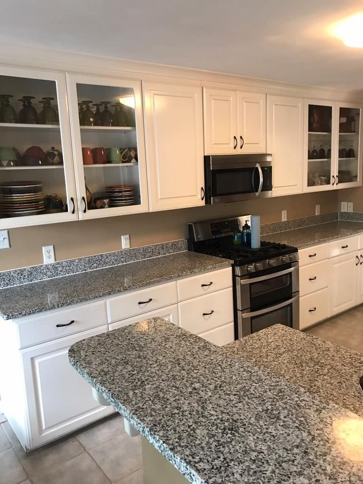Gramercy White Kitchen Cabinet And Zyca Granite Countertop
