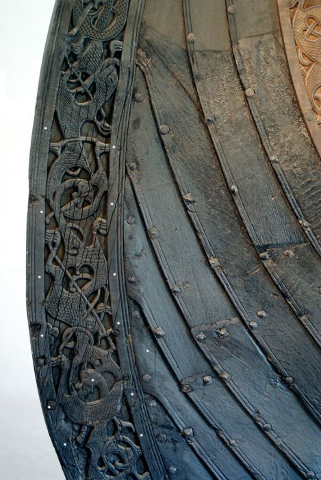 Viking ship detail at the Viking Ship Museum in Oslo, notice the detailed Celtic patterns combined with animals on a Viking ship.  The Oseberg ship was buried in 834 CE.