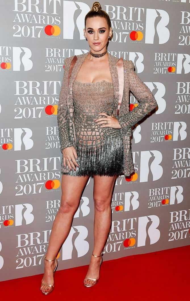 Katy Perry in a beaded mini dress and blazer at the Brit Awards