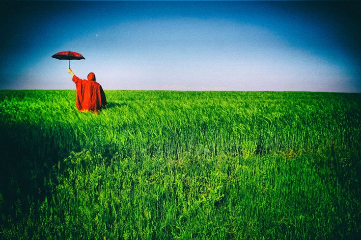 red facing spring Agriculture Blue Sky Colourful Conceptual Crop  Dreaming Field Fine Art Fine Art Photograhy Grass Green Color Growth Landscape Lanscape Photography Moon Nature Outdoors Red Character Red Clouds Red Umbrella Rural Scene Scarecrow Solitude Springtime Surrealism