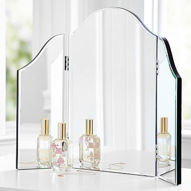 I found this on Pottery Barn Teen today, this is exactly what I've been looking for!!! They have alot of cool stuff on that website, even if its for teens. Mirrored Trifold Vanity.