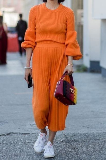Loving this orange sweater and pleated skirt.. pairing them with white tennis shoes makes this look so effortless!