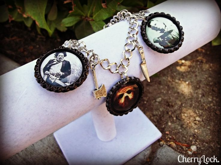 """ORIG. $25FREE SHIPPING IN THE US7""""-7.5"""" bracelet 3 1"""" round hand flattened black bottle cap charms 6 hand cut quality 1"""" round images Thick, crystal clear epoxy domes for image protection Horror charm assortment varies with - spider, butcher knife, axe, bat, brass knuckles, jack-o-lantern, vampire teeth, skeleton, hearse etc.Available in Silver caps or Black"""