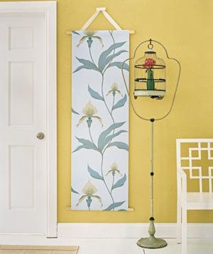 """""""Don't be afraid to choose a large piece of statement-making art (like this scroll) in a small space like an entry."""""""