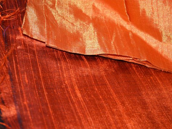 Iridescent Burnt / Dark Orange and Black 100% dupioni silk fabric with Gold Border on both slevage sold by the Yard