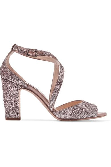 """MADE TO DANCE: Jimmy Choo's 'Carrie' sandals are designed to """"provide the ultimate comfort"""" – they have wide crossover straps and a sturdy block heel. This pair is made from supple leather and saturated with flecks of antique-rose glitter. Wear yours with cuffed jeans."""
