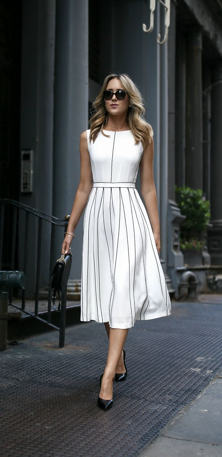 white pleated sleeveless a-line midi dress with black piping illusion pleats // …