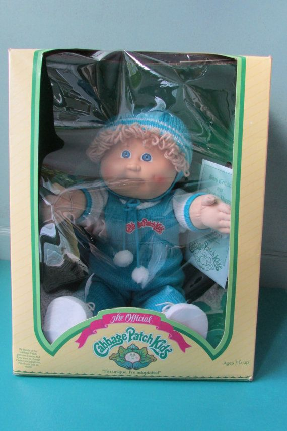 This Cabbage Patch Kids doll was made in 1983/1984. It is a male doll with birth certificate & adoption papers. The name on the papers is Donald Lester, but you can change his name if you would like. An adorable doll with a fun blue knit outfit, including a hat & little white shoes. Please see all pictures for details & condition of box. (Minor wear of box.) Ages 3 & up. Never removed from box. He has blue eyes & a dimple on his left cheek.  Made by COLECO. Box measures--11 1/2 W X 15 L X 9…