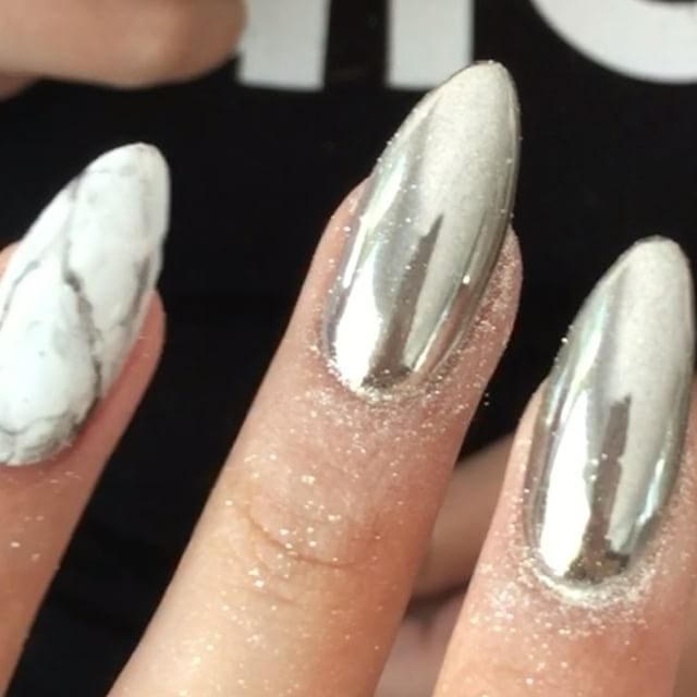 Getting chromed out fingers by my amazing nail artist @yvynails ...she has crazy products from all over the world that do incredible things like this chrome powder, I just had to show you guys! She said no one really has this product in the US yet! Song: Awake by Tycho #nails #nailart #chrome #nailswag